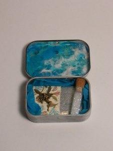 Mint tin shrine to magic.