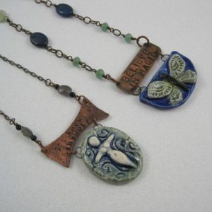 """My """"Mythic Nature"""" line of ceramic pendants are original designs, hand carved in clay. I make plaster molds of the original, streamlining the process and allowing for color variations.They are all handpainted in a mix of glazes and underglazes, front and back, and fired in my kiln.These pendants are paired with hand stamped elements and semi-precious gems to complete the necklaces.Necklaces showcasing my """"Mythic Nature"""" pendants range in price from $40-75 based on materials, length, and complexity."""