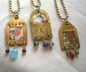 I have a fondness for vintage illustrations. These sweet images came from a Children's encyclopedia that was in my family when I was young. I have used the originals, so very one of a kind with their limited palette.Brass shrines, hand stamped with inspirational words. a sliver of mica to protect the original illustration. Gemstone embellishments. $50