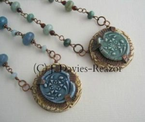 This is the new style of mixed media amulet that I have been investigating in 2013. I am thrilled and excited about the possibilities. I will be teaching this class at Beadfest Philadelphia in August 2014.Porcelain cabochon, polymer, copper, paint, gems...