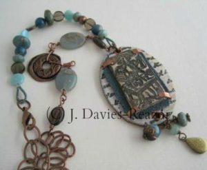 Polymer, copper, leather, paint, artisan bronze charm, apatite, smokey quartz, amazonite, jasper, gems, chain...